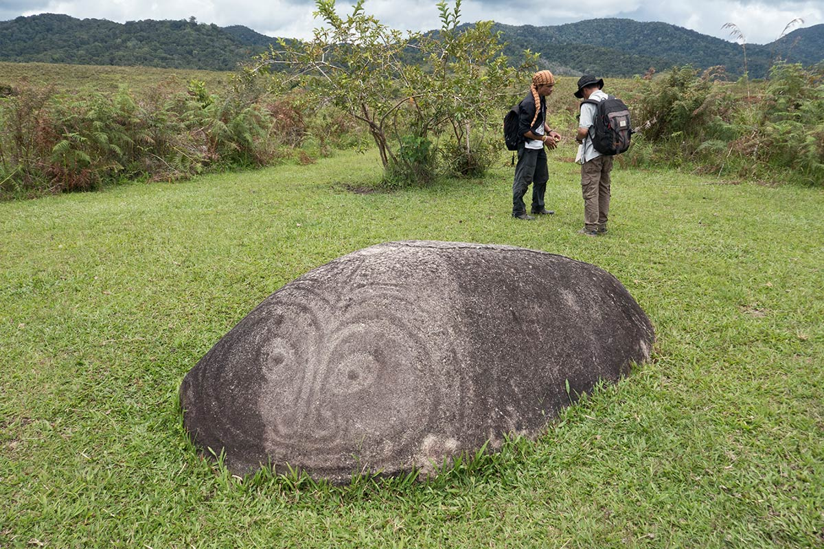 Watu Molindo monolith with enigmatic face etched on surface, near Bulili village, Besoa Valley